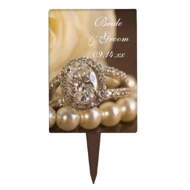 Oval Diamond Ring and White Rose Wedding Cake Topper